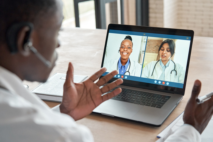 shutterstock Multiracial MDs chatting on video 710px
