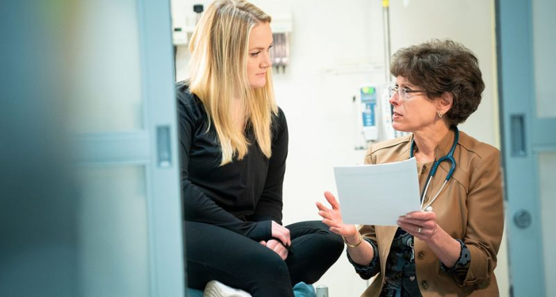 young woman patient consults with physician